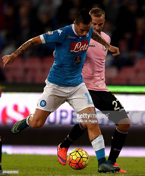 Marek Hamsik of Napoli is chaleenged by Luca Rigoni of Palermoduring the Serie A match between SSC Napoli and US Citta di Palermo at Stadio San Paolo...