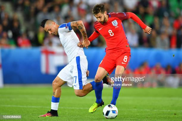 Marek Hamsik of Slovakia and Adam Lallana of England challenge for the ball during the preliminary round Group B match between Slovakia and England...