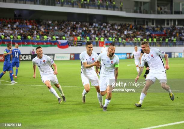 Marek Hamsik of Slovakia celebrates with his teammates after scoring during a UEFA Euro 2020 European Championship Qualifiers Group E match between...