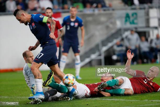 Marek Hamsik of Slovakia is challenged by Peter Gulacsi of Hungary , Willi Orban of Hungary and Botond Barath of Hungary during the 2020 UEFA...