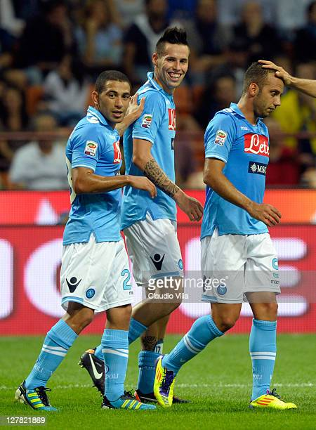 Marek Hamsik of SSC Napoli celebrates with teammates after scoring their team's third goal during the Serie A match between FC Internazionale Milano...