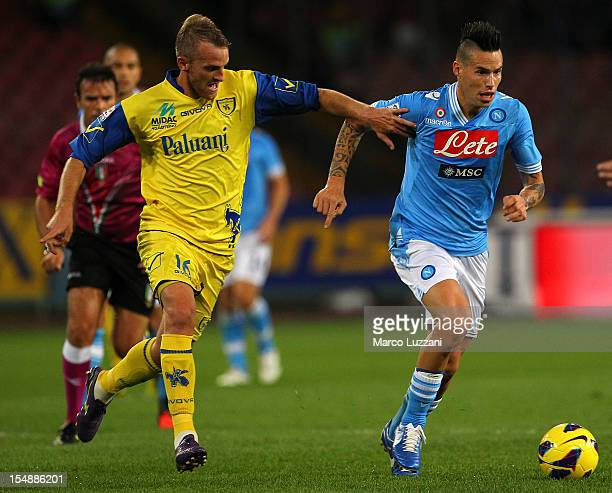 Marek Hamsik of SSC Napoli competes for the ball with Luca Rigoni of AC Chievo Verona during the Serie A match between SSC Napoli and AC Chievo...