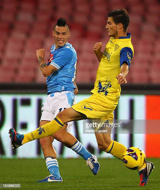 Marek Hamsik of SSC Napoli competes for the ball with Marco Andreolli of AC Chievo Verona during the Serie A match between SSC Napoli and AC Chievo...