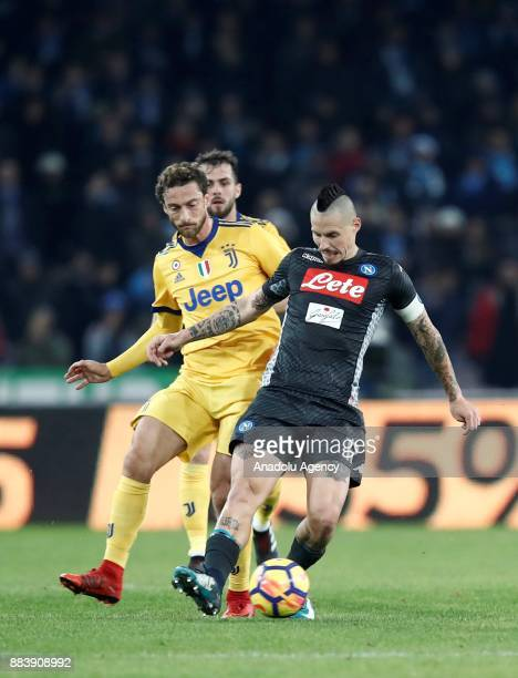 Marek Hamsik of SSC Napoli in action against Claudio Marchisio of Juventus during the Serie A football match between SSC Napoli and FC Juventus at...
