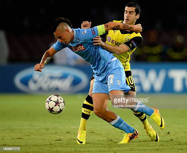 Marek Hamsik of SSC Napoli is challenged by Henrikh Mkhitaryan of Borussia Dortmund during the UEFA Champions League Group F match between SSC Napoli...