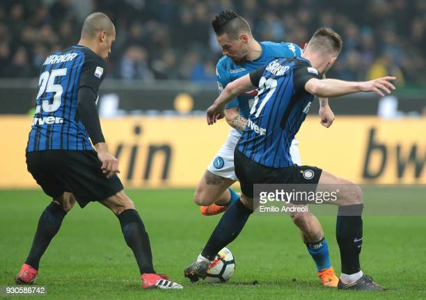 Marek Hamsik of SSC Napoli is challenged by Milan Skriniar and Joao Miranda de Souza Filho of FC Internazionale Milano during the serie A match...