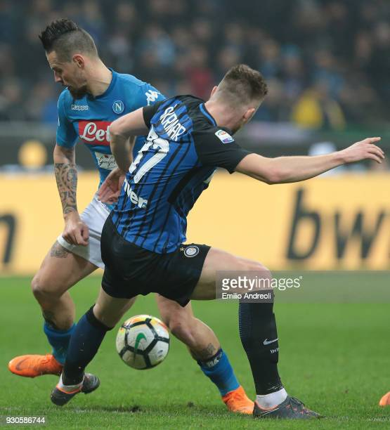 Marek Hamsik of SSC Napoli is challenged by Milan Skriniar of FC Internazionale Milano during the serie A match between FC Internazionale and SSC...
