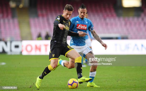 Marek Hamsik of SSC Napoli vies Andrea Pinamonti of Frosinone Calcio during the Serie A match between SSC Napoli and Frosinone Calcio at Stadio San...
