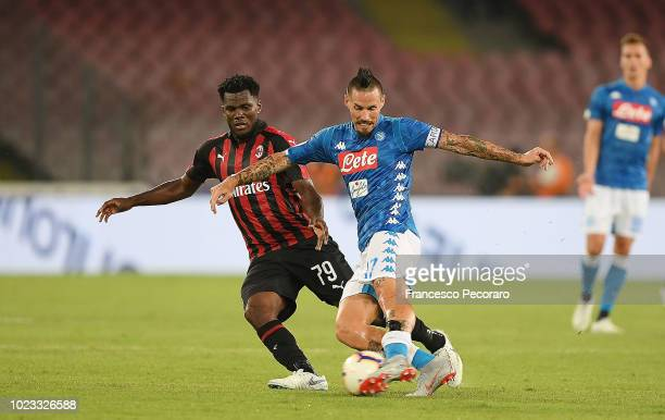 Marek Hamsik of SSC Napoli vies Franck Kessie of AC Milan during the serie A match between SSC Napoli and AC Milan at Stadio San Paolo on August 25...
