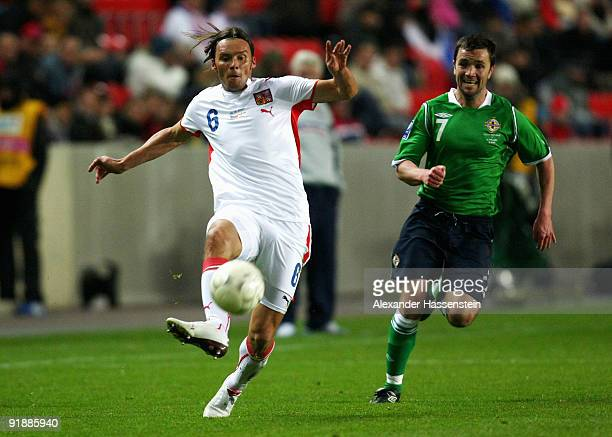 Marek Jankulovski of Czech Republic battles for the ball with Damien Johnson of Northern Ireland during the FIFA 2010 World Cup Group 3 Qualifier...