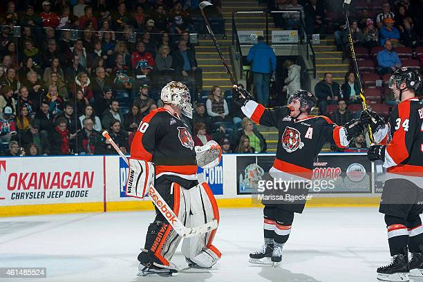 Marek Langhamer of Medicine Hat Tigers is congratulated by teammates on the win against the Kelowna Rockets on January 10 2015 at Prospera Place in...