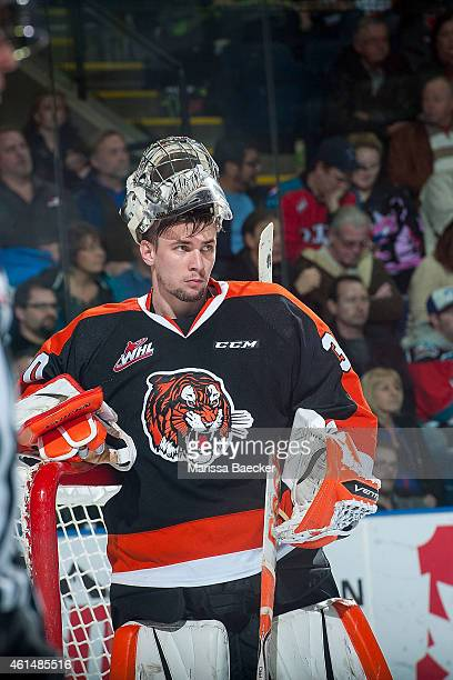 Marek Langhamer of Medicine Hat Tigers stands in net without his mask at the timeout against the Kelowna Rockets on January 10 2015 at Prospera Place...