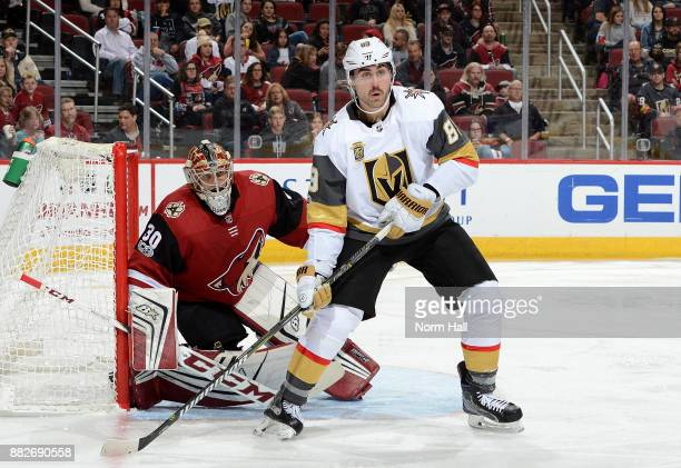 Marek Langhamer of the Arizona Coyotes gets ready to make a save as Alex Tuch of the Vegas Golden Knights looks for the puck at Gila River Arena on...