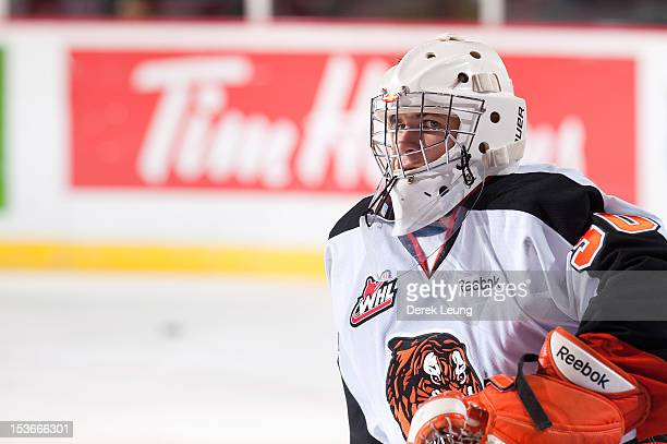 Marek Langhamer of the Medicine Hat Tigers stretches during warmups before the game against the Vancouver Giants in WHL action on October 5 2012 at...