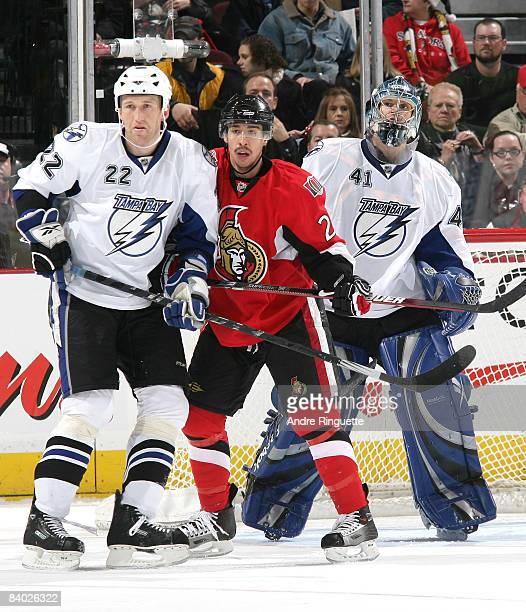 Marek Malik and Mike Smith of the Tampa Bay Lightning defend against Chris Kelly of the Ottawa Senators at Scotiabank Place on December 13 2008 in...