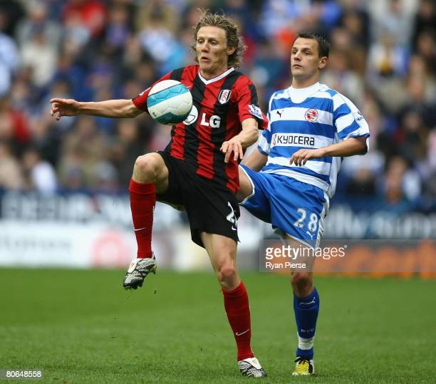 Marek Matejovsky of Reading competes for the ball against Jimmy Bullard of Fulham during the Barclays Premier League match between Reading and Fulham...