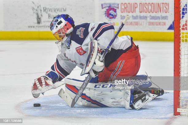 Marek Mazanec of the Hartford Wolf Pack covers the puck during a game against the Bridgeport Sound Tigers at the Webster Bank Arena on January 12...