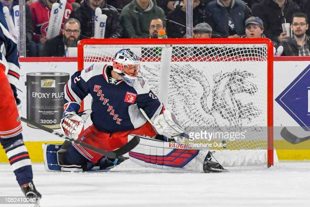Marek Mazanec of the Hartford Wolfpack makes a pad save against the Laval Rocket at Place Bell on October 17, 2018 in Laval, Quebec.