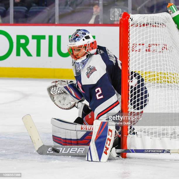 Marek Mazanec of the Hartford Wolfpack makes a stick save against the Laval Rocket at Place Bell on October 17 2018 in Laval Quebec