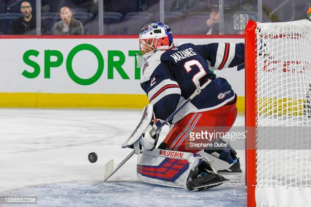 Marek Mazanec of the Hartford Wolfpack makes a stick save against the Laval Rocket at Place Bell on October 17, 2018 in Laval, Quebec.