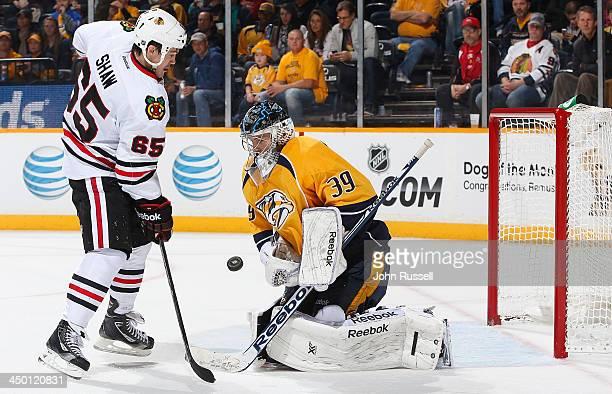 Marek Mazanec of the Nashville Predators blocks a shot against Andrew Shaw of the Chicago Blackhawks at Bridgestone Arena on November 16 2013 in...