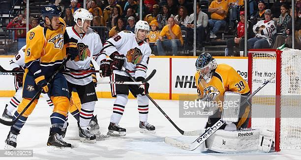 Marek Mazanec of the Nashville Predators blocks a shot against Patrick Kane of the Chicago Blackhawks at Bridgestone Arena on November 16 2013 in...