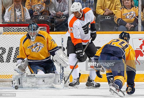 Marek Mazanec of the Nashville Predators blocks a shot against Wayne Simmonds of the Philadelphia Flyers at Bridgestone Arena on November 30 2013 in...