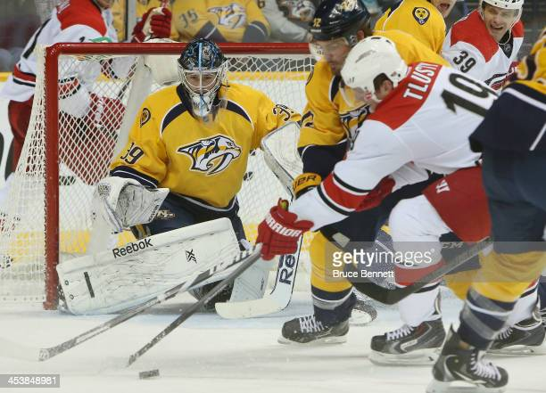 Marek Mazanec of the Nashville Predators keeps his eyes on the puck as Jiri Tlusty of the Carolina Hurricanes moves to makes a shot at the...