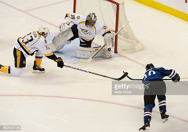 Marek Mazanec of the Nashville Predators makes a glove save on a shot by Ryan O'Reilly of the Colorado Avalanche in the second period at Pepsi Center...