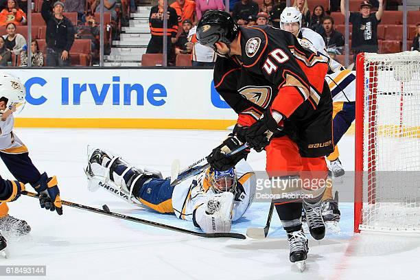 Marek Mazanec of the Nashville Predators makes a save against Jared Boll of the Anaheim Ducks on October 26 2016 at Honda Center in Anaheim California