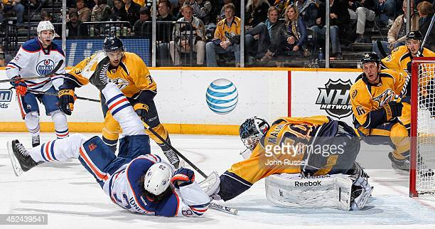 Marek Mazanec of the Nashville Predators makes the save against Ryan Jones of the Edmonton Oilers at Bridgestone Arena on November 28 2013 in...