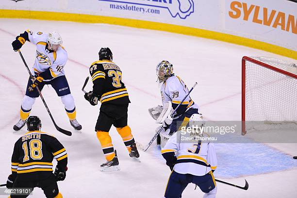 Marek Mazanec of the Nashville Predators misses the puck to let in an overtime goal against the Boston Bruins at the TD Garden on January 2 2014 in...