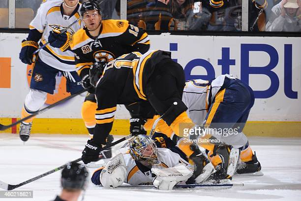 Marek Mazanec of the Nashville Predators slides out on the ice to make a save against the Boston Bruins at the TD Garden on January 2 2014 in Boston...