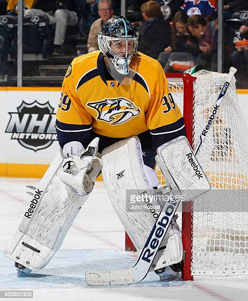 Marek Mazanec of the Nashville Predators tends net against the Edmonton Oilers at Bridgestone Arena on November 28 2013 in Nashville Tennessee