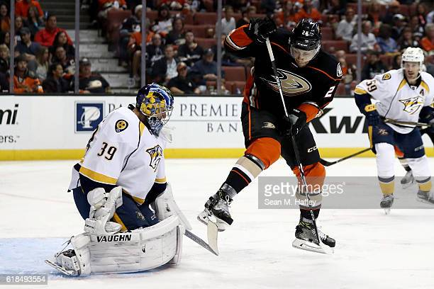 Marek Mazanec of the Nashville Predators tends net as Emerson Etem of the Anaheim Ducks attempts to deflect the shotduring the third period of a game...