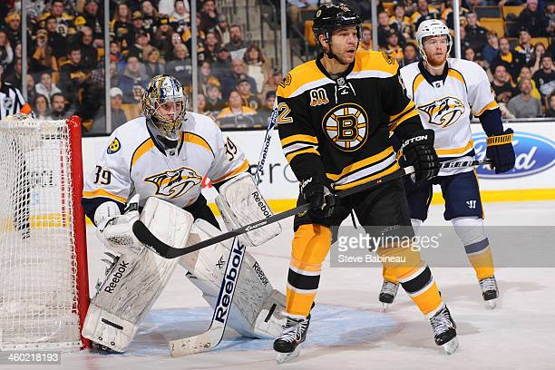 Marek Mazanec of the Nashville Predators watches the puck against Jarome Iginla of the Boston Bruins at the TD Garden on January 2 2014 in Boston...