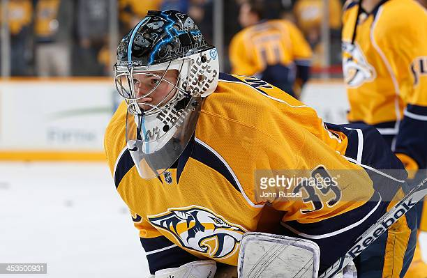 Marek Mazanec of the Nashville Predators watches warmups prior to the game against the Edmonton Oilers at Bridgestone Arena on November 28 2013 in...