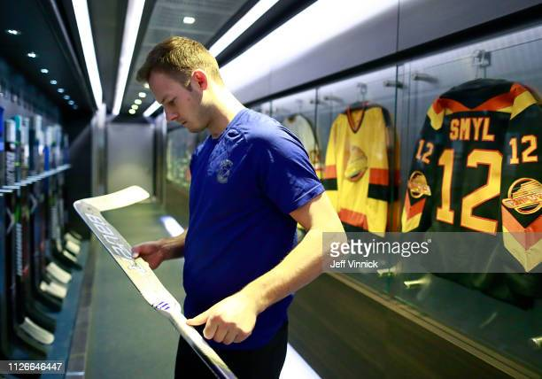 Marek Mazanec of the Vancouver Canucks checks his stick before their NHL game against the Arizona Coyotes at Rogers Arena February 21 2019 in...
