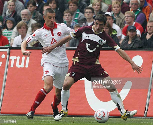 Marek Mintal of Nuernberg battles for the ball with Lars Stindl of Hannover during the Bundesliga match between Hannover 96 and 1 FC Nuernberg at AWD...