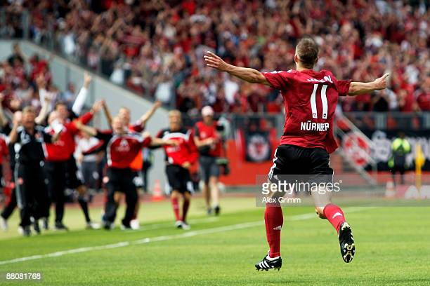 Marek Mintal of Nuernberg celebrates his team's second goal during the Bundesliga Play Off leg two match between 1. FC Nuernberg and Energie Cottbus...