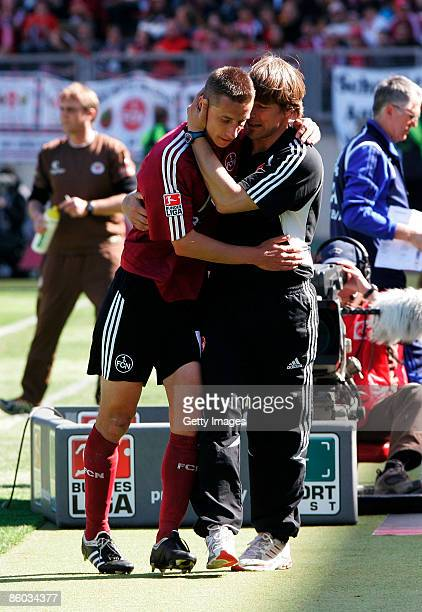 Marek Mintal of Nuernberg is celebrated by his head coach Michael Oenning after scoring the second goal during the second Bundesliga match between 1....