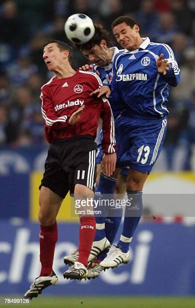 Marek Mintal of Nuremberg goes up for a header with Mladen Krstajic and Jermaine Jones of Schalke during the Bundesliga match between Schalke 04 and...