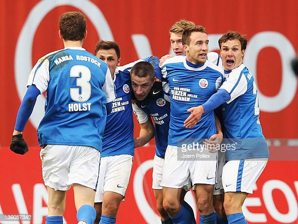 Marek Mintal of Rostock celebrates with his team mates after scoring his team's second goal during the Second Bundesliga match between FC Hansa...