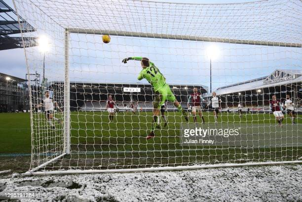Marek Rodak of Fulham makes a save during The Emirates FA Cup Fourth Round match between Fulham and Burnley at Craven Cottage on January 24, 2021 in...