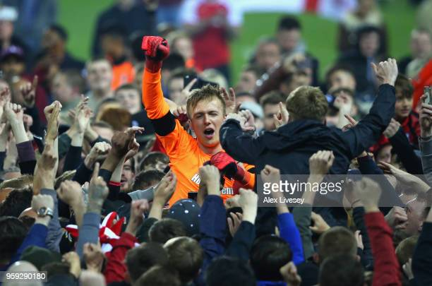 Marek Rodak of Rotherham United is carried by supporters after victory in the Sky Bet League One Play Off Semi Final second leg match between...