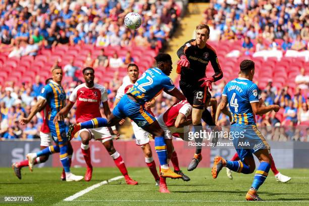 Marek Rodak of Rotherham United punches clear from Aristote Nsiala of Shrewsbury Town during the Sky Bet League One Play Off Final between Rotherham...
