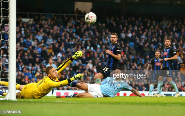 Marek Rodak of Rotherham United saves a shot from Gabriel Jesus during the FA Cup Third Round match between Manchester City and Rotherham United at...