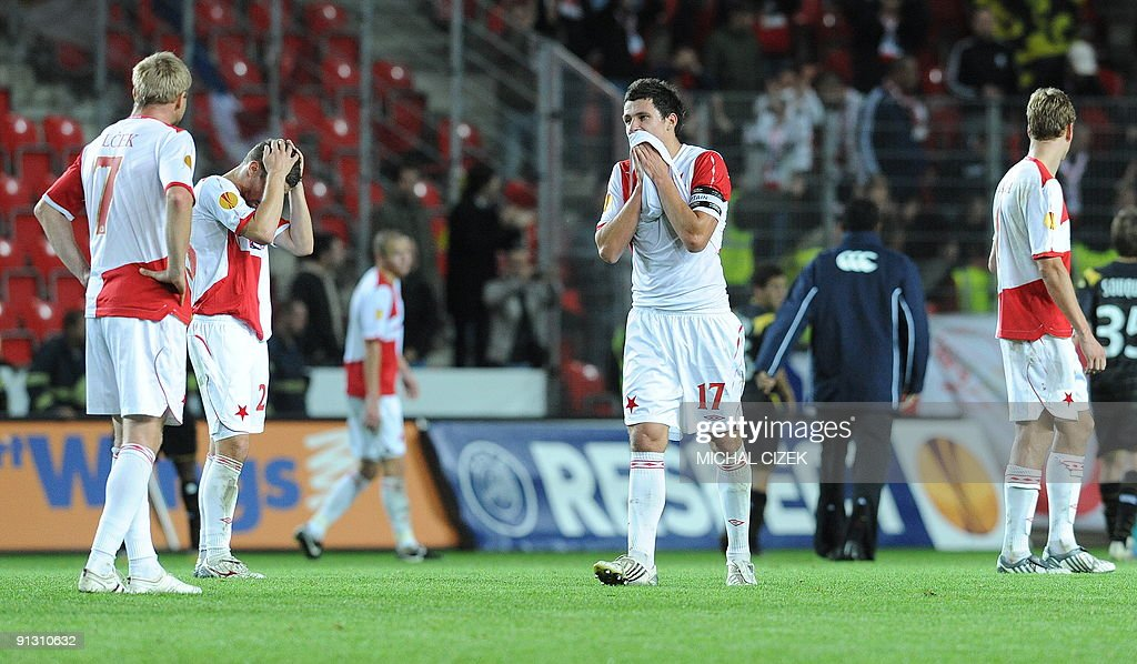 Marek Suchy of Slavia Prague (c) and his teammates react after the UEFA Europa League Group B football match between Slavia Prague and Lille on October 1, 2009 in Prague. Lille defeated Slavia 5-1.