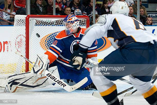 Marek Svatos of the Nashville Predators makes a save on a shot from Shea Weber of the Nashville Predators at Rexall Place on January 23 2011 in...