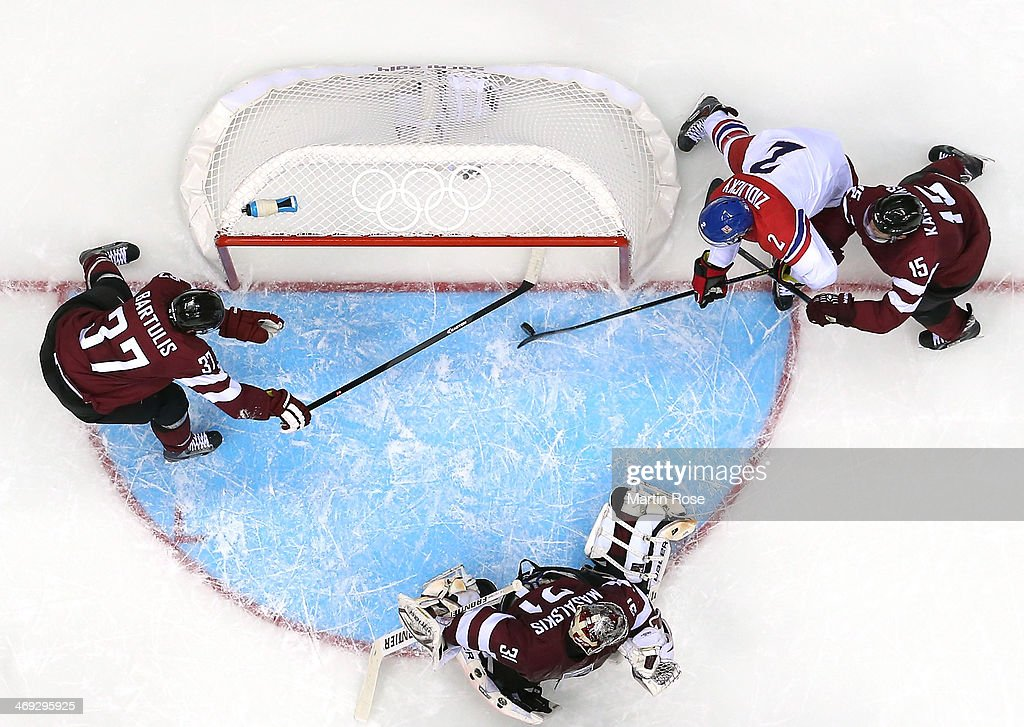 Marek Zidlicky #2 of Czech Republic scores against Martins Karsums #15 and Edgars Masalskis #31 of Latvia in the second period during the Men's Ice Hockey Preliminary Round Group C game on day seven of the Sochi 2014 Winter Olympics at Bolshoy Ice Dome on February 14, 2014 in Sochi, Russia.